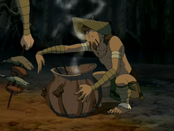 Foggy Swamp Tribesman cooking.png