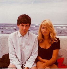 Paul in Tenerife with their old Bass play Stuart Sutcliffe's wife Astrid Kirchkerr