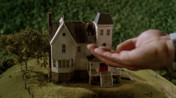 Opening-Title-Credit-Sequence-Beetlejuice-Adam's-hand-reaching-out-for-spider-climbing-over-miniature-house