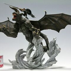 Art of War statue depicting Zodd and Guts facing <a href=