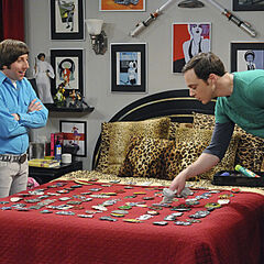 Sheldon cleaning Howard's belt buckles for a chance with Stephen Hawking.