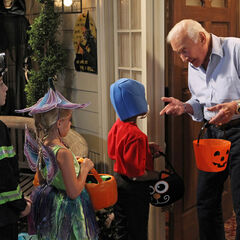 Buzz Aldrin giving out candy for Halloween.
