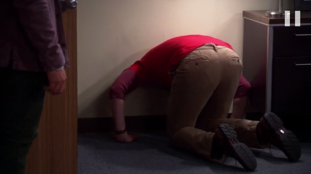 File:Sheldon stuck in the wall.png