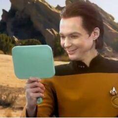 Sheldon admiring his makeup.
