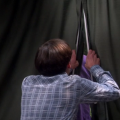 Howard pulling the drapes closed hiding Sheldon.