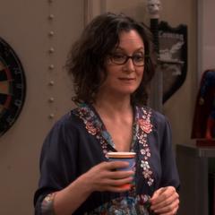 Leslie toasting Sheldon.