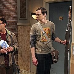 Sheldon holds his life-size Spock cutout as Leonard glances at Penny's apartment.