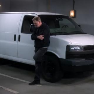 Waiting by his nondescript white van.