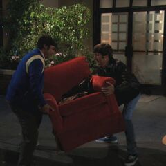 Carrying Penny's discarded chair up to 4A for Raj to use.