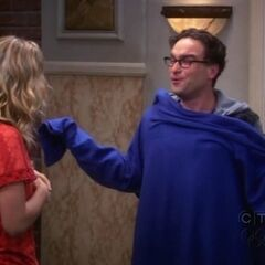 Penny gives Leonard a snuggie.