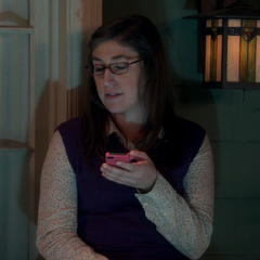 Amy reading a text from the drunken Sheldon.
