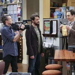 Sheldon showing off the napkin with Leonard Nimoy's DNA on it.
