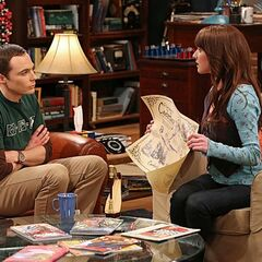 Alex showing Sheldon the Valentines' Day gifts she bought for him for Amy.