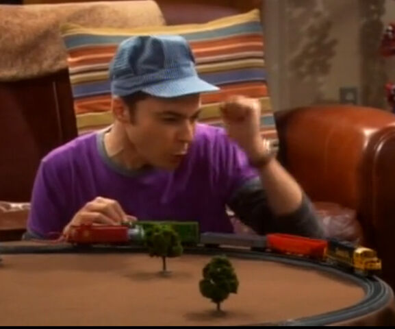 File:Sheldon plays with trains.jpg