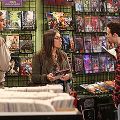 Amy meets Stuart at the comic bookstore as Sheldon looks on, unaware of Stuart's intentions.