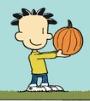 Nate holding a pumpkin