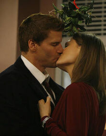 Booth-and-brennan-kiss-under-the-mistletoe-in-season-3s-the-santa-in-the-slush