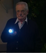Mr. Fenny holding a flashlight in 2015