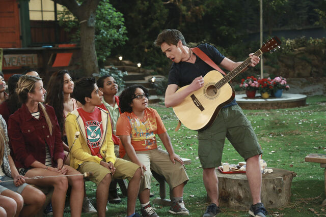 File:Pilot (Xander playing guitar with Jorge and Ravi) Campfire.jpg