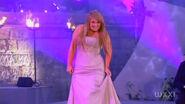Chloë smirks on the stage