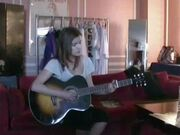 Lynn playing the guitar & singing at one time