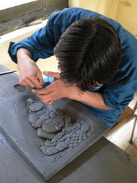 Slate carving, School of Traditional Arts, Thimphu.jpg