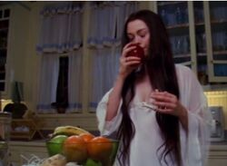 Paige takes a bite from the poison apple
