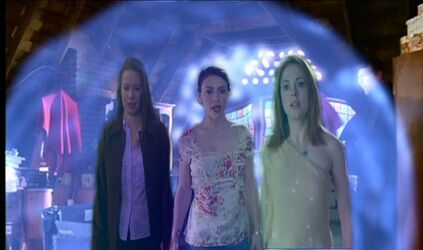 Paige in Her Shield With Piper and Phoebe