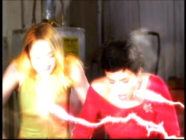 File:Paige gets shocked to death with Phoebe.jpg