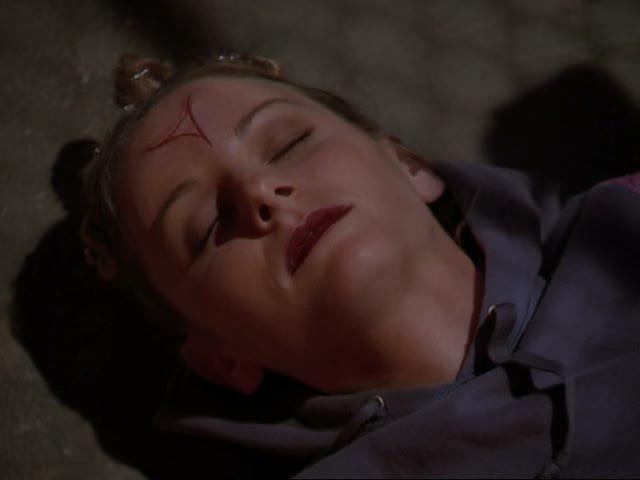 File:Dead raver girl with rune on her forehead.jpg