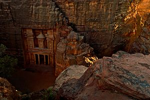 The Treasury (Al Khazneh) in Petra at sunset, viewed from the top of the Siq.jpg