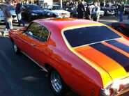 Orange and red 1969 chevelle