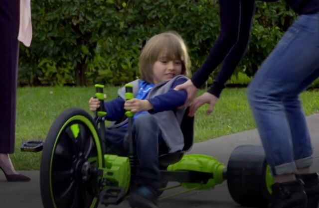 File:S06E02-Greg on green machine.jpg