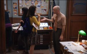 Annie and Pelton in the newsroom