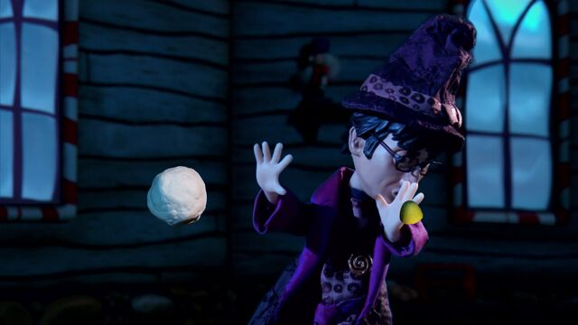 File:S02E11-Christmas Wizard being pelted.jpg