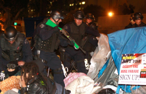 Usonian police forces arresting members of a liberal rally in 2004