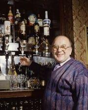 Roy alec behind the bar