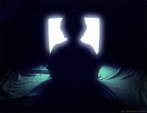 Child-watching-television-silhouette