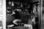 Bartender speaking with a client, Paris