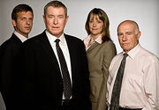 Midsomer Murders cast from left to right - Jason Hughes as DS Ben Jones, John Nettles as DCI Tom Barnaby, Kirsty Dillon as DC Gail Stephens and Barry Jackson as Dr George Bullard