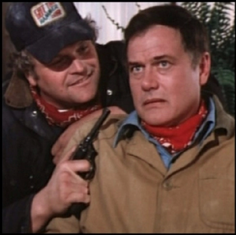 File:Dallas episode 1x4 - Luther Frick holding J.R. hostage.png