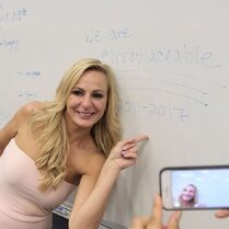 724 HQ - Christi with sign