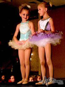 Young Chloe and Paige in tutus