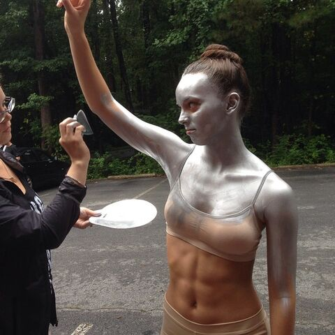 File:Payton silver body paint on set of High Hello.jpg