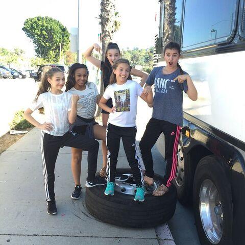 File:Posing on bus tire 2015-04-18.jpg