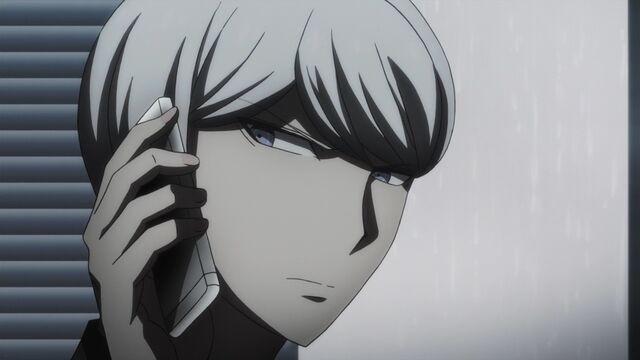 File:Munakata on the phone.JPG