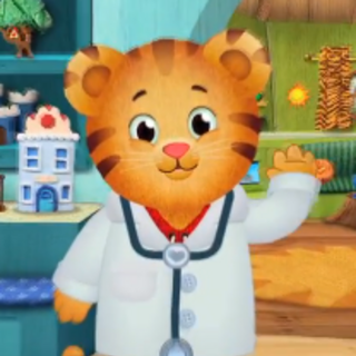 Daniel in a doctor outfit, from