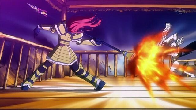 File:Erza about to throw her spear at the moon.jpg