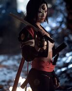 Katana with sword resting on her shoulder