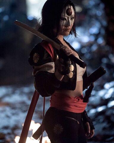 File:Katana with sword resting on her shoulder.jpg